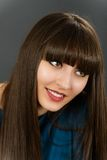 Young beautiful woman with bangs in studio Royalty Free Stock Photo