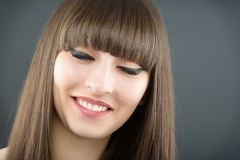 A young beautiful woman with bangs in studio Stock Images