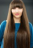 A young beautiful woman with bangs in studio Royalty Free Stock Photos