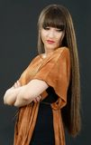 A young beautiful woman with bangs in studio Royalty Free Stock Photo