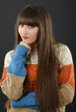 A young beautiful woman with bangs in studio Stock Image