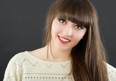 A young beautiful woman with bangs in studio Royalty Free Stock Photography