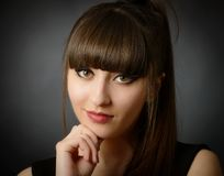 A young beautiful woman with bangs in studio Stock Photography