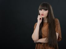A young beautiful woman with bangs in studio Stock Photo