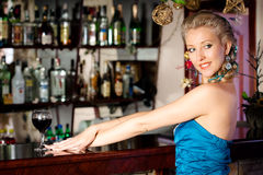 Young beautiful woman at a bar counter Stock Images