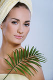 Young beautiful woman after bath. Touching face green plants stock images