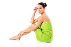 Young beautiful woman after bath full portrait over white. royalty free stock photo