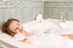 Young beautiful woman in a bath Stock Photos
