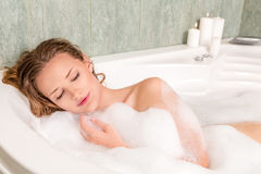 Young beautiful woman in a bath Stock Images