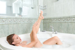 Young beautiful woman in a bath Stock Photography