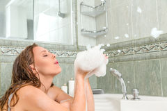 Young beautiful woman in a bath Royalty Free Stock Photo
