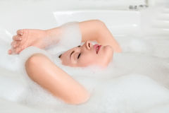 Young beautiful woman in a bath Royalty Free Stock Image