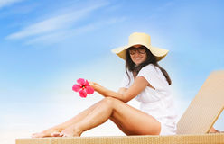 Young beautiful woman on beach Stock Image