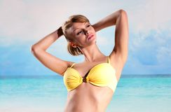 Young beautiful woman on the beach Stock Photos