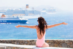Young beautiful woman on the beach background big cruise ship. Royalty Free Stock Images