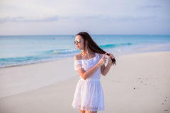 Young beautiful woman on beach during her summer Stock Photography