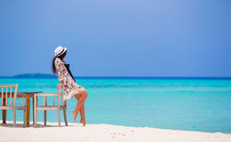 Young beautiful woman on beach during her summer Stock Images