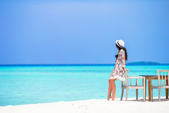 Young beautiful woman on beach during her summer Stock Image