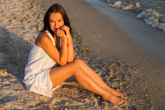 Young beautiful woman on the beach Stock Photo