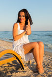 Young beautiful woman on the beach Royalty Free Stock Photos