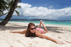 Young beautiful woman on the beach Stock Photography