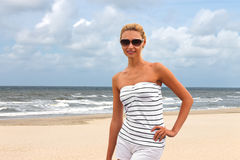 Young beautiful woman on the beach Royalty Free Stock Photo