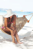 Young beautiful woman on the beach Royalty Free Stock Image
