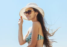 Young beautiful woman on the beach Stock Image
