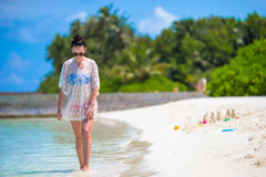 Young beautiful woman on beach during tropical Stock Images