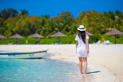 Young beautiful woman on beach during tropical Royalty Free Stock Images