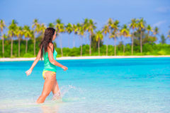 Young beautiful woman on beach during tropical Stock Photography