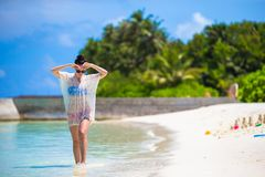 Young beautiful woman on beach during tropical Stock Photos