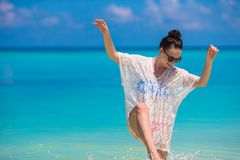 Young beautiful woman on beach during tropical Stock Photo