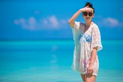 Young beautiful woman on beach during tropical Royalty Free Stock Photos