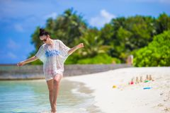 Young beautiful woman on beach during tropical Stock Image