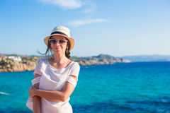 Young beautiful woman on beach during tropical vacation Royalty Free Stock Image
