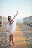 Young beautiful woman on beach during tropical vacation Royalty Free Stock Images
