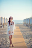 Young beautiful woman on beach during tropical vacation Stock Images