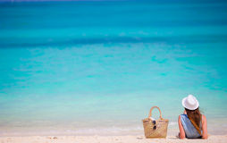 Young beautiful woman on beach vacation. Happy girl enjoy beach and warm weather relaxing on the ocean Stock Images