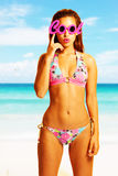 Young beautiful woman  on the beach wearing cool glasses Royalty Free Stock Photo