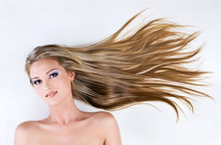 Young beautiful woman with beauty hairs Stock Photography