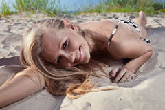 Young beautiful woman on a bech. The young beautiful woman on a bech Stock Image