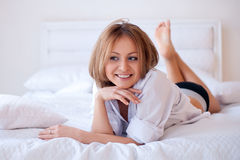 Young beautiful woman on bed Stock Photo
