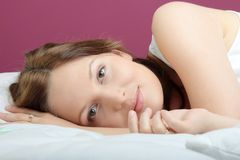 Young beautiful woman on bed Royalty Free Stock Image