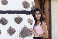 Young beautiful woman behind an old stone wall, outdoor shot Royalty Free Stock Photos