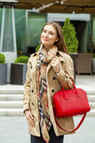 Young beautiful woman in beige short coat posing outdoors in spr Stock Photography