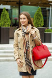 Young beautiful woman in beige short coat posing outdoors in spr Royalty Free Stock Photography
