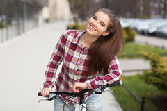 Young beautiful woman on a bicycle Stock Images