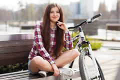 Young beautiful woman on a bicycle Stock Image