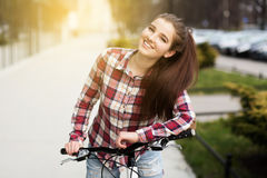 Young beautiful woman on a bicycle stock photo